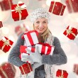 Composite image of happy blonde with gifts — Stock Photo #53901897