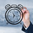 Business person drawing black clock — Stock Photo #53902683