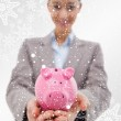 Happy businesswoman showing a piggy bank — Stock Photo #53902693