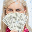 Blonde hiding her face with dollars banknotes — Stock Photo #53902933