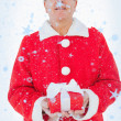 Festive man holding christmas gift — Stock Photo #53903303