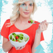 Young blonde woman eating a vegetable salad — Stock Photo #53903401
