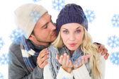 Couple in winter fashion against snowflakes — Stockfoto