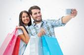 Attractive young couple with shopping bags — Stock Photo