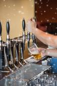 Barman pulling pint of beer — Stock Photo