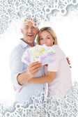 Happy couple flashing their cash — Stock Photo