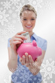Money being put into piggy bank by woman — Stock Photo