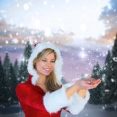 Girl holding hands out in santa outfit — Stock Photo