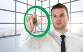 Serious businessman pointing to clock — Stock Photo