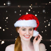 Pretty girl in santa costume smiling — Стоковое фото