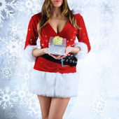 Sexy santa girl holding gift — Photo