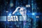 Word data and businesswoman thinking — Stock Photo