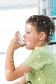 Boy using asthma inhaler in hospital — Stock Photo