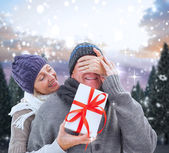 Woman surprising partner with gift — Stockfoto