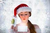 Girl in santa costume opening gift — Стоковое фото