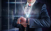 Businessman using hologram watch — Stock Photo