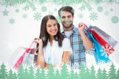 Attractive young couple with shopping bags — Stok fotoğraf