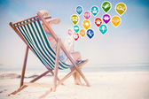 Woman on beach using tablet — Stock Photo