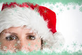 Portrait of pretty woman in santa hat — Stockfoto