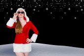 Cool santa girl wearing sunglasses — Stock Photo