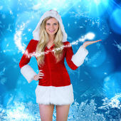 Pretty girl presenting in santa outfit — Stock Photo