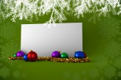 Composite image of poster with baubles — Stock Photo