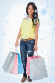 Beautiful woman student with shopping bags — Stock Photo