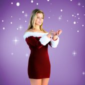 Composite image of pretty girl holding hands out in santa outfit — Stock Photo