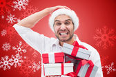 Festive man holding christmas gift — Stock Photo