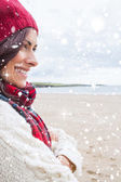 Woman in knitted hat and pullover smiling — Stock Photo