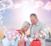 Couple with shopping bags — Stock Photo