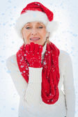 Composite image of festive woman blowing a kiss — Stock Photo