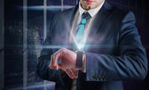 Businessman using hologram watch — Foto de Stock