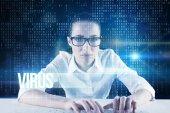 Businesswoman typing on keyboard — Stock Photo
