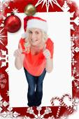 Fairhaired woman putting her thumbs up — Stockfoto