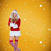 Pretty girl in santa outfit with arms crossed — Stock Photo