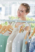 Happy female customer selecting clothes — Stock Photo