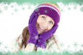 Composite image of glowing woman wearing gloves and cap  — Stockfoto