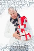 Mature man in winter clothes holding gifts — Foto de Stock