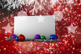 Composite image of poster with baubles — Photo