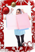 Joyful woman showing shopping bags — Stockfoto