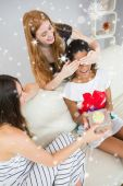 Cheerful young women surprising friend — Stock Photo