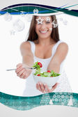 Delicious salad being eaten by a young woman — Stock Photo