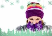 Composite image of freeze woman with gloves and a hat — Stock Photo