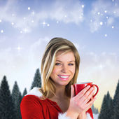 Pretty santa girl holding mug — Stock Photo