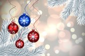Composite image of digital hanging christmas bauble decoration — Stock Photo