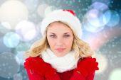 Composite image of happy festive blonde — Stock Photo