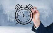 Business person drawing black clock — Stock Photo