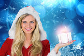Pretty girl in santa outfit holding gift — Stock Photo