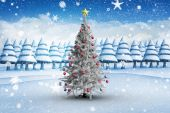 Christmas tree with baubles and star — Foto de Stock